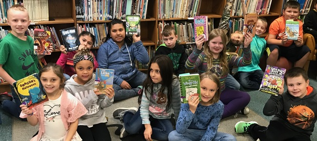 Kids Showing Library Books